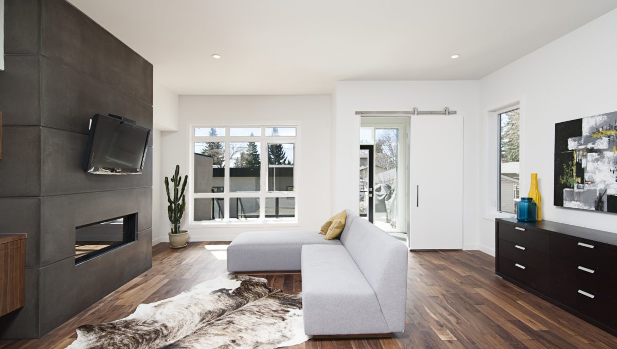 Beautiful interior shot of a modern house with white relaxing walls and furniture and technology