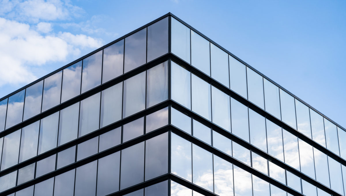 Facade glass building background on a blue sky